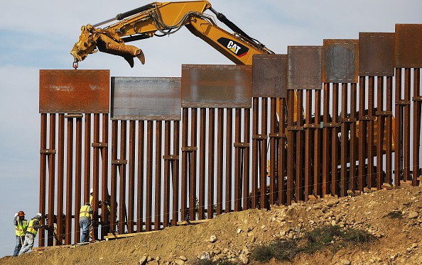 Illegals Pour Through Unfinished Border Wall After Biden Halts Construction