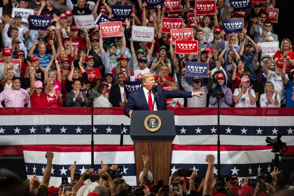"Trump Campaign Trolls Media, Gives NC Rally-Goers ""Peaceful Protester"" Signs"