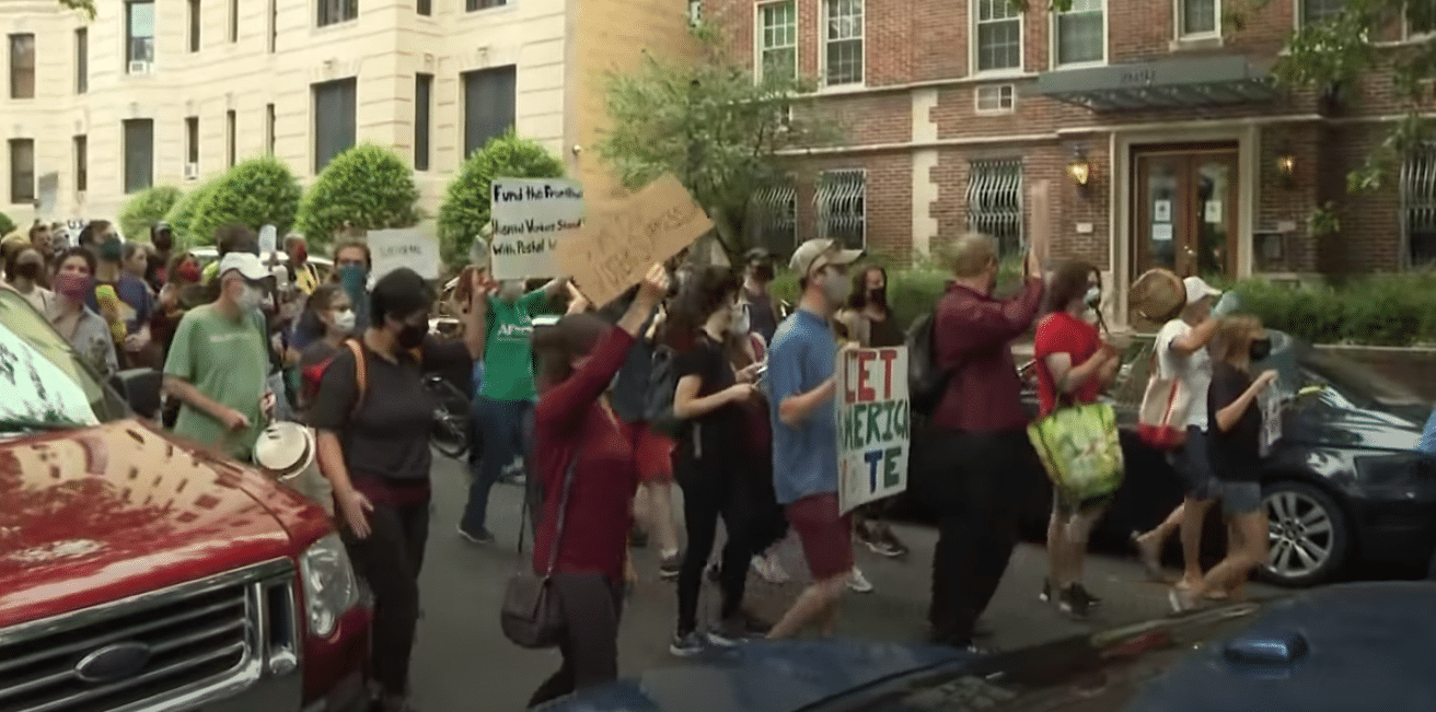 Group of Liberals Meet in Person to Protest Against Voting in Person