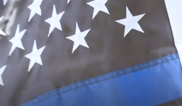 High Schoolers Suspended for Carrying Pro-Police Flags on Football Field Awarded Scholarships